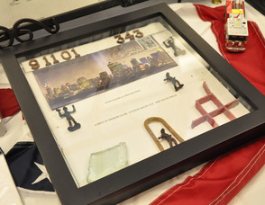 Items Thomas Cooney recovered at Ground Zero including a piece of window glass, standpipe hose clip, and fire truck grill.
