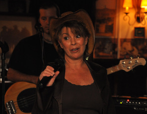Barbara Toth, owner of the Village Saloon, thanks the crowd.
