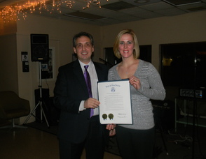 Business Owners Michelle Brugger and Jimmy Vardas with the resolution