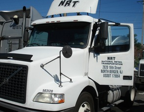 NRT from N. Bergen, NJ (picture of white truck with NRT on the door), caption -   NRT is just one of many NJ trucking companies forced to adopt equipment that hurts the performance of the truck's output.  This truck actually was retrofitted with a SMART Emissions Reducer, and became compliant for far less cost than equipment listed on the EPA Verified Technologies List. .