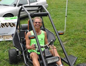 Joe Farinella sits in a Sidewinder ATV.