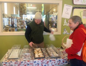 A customer buys up a scone from Rob Cadigan of The Pear Tree Pantry.