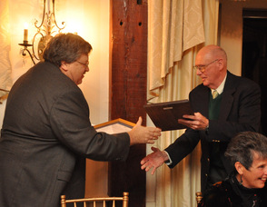 Stephen J. Stevkovich receives his award from Frank Virtue.