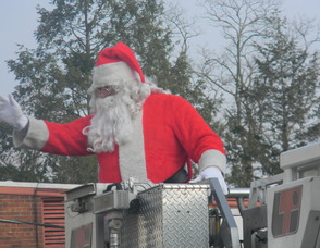 Santa arriving on the firetruck