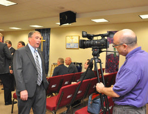 Jerry Morelli of Mugs Media filming Harold Wirths, Commissioner of the State Department of Labor and Workforce Development.