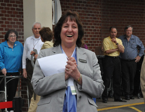 General Store Manager Carole Bracaglia applauds Spires.