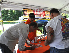 John Schneider signs for fans at Franklin Sussex Auto Mall at the outdoor event.