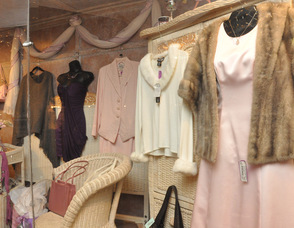 An array of outfits in the window of Diva Designs.