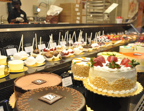 An array of baked goods, including Balducci's cakes.