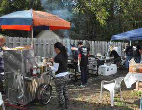 Clams, hot dogs, and other items being cooked up at the event.
