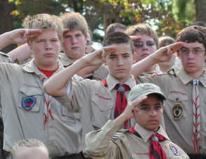 Scouts salute during the raising of the flag.