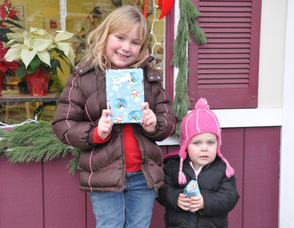 Madeline and Claire Meyler, ages 5 and 19 months,with their gifts.