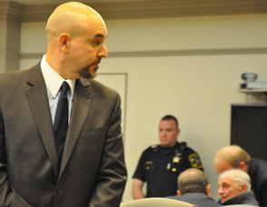 Sussex County First Assistant Prosecutor Gregory Mueller, looks over his shoulder as Michael Stabile's attorneys subdue their client.