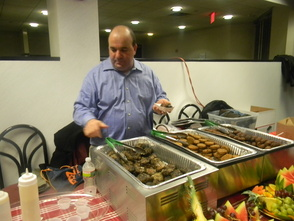 Co-owner Yoram Aflalo of Deena's Delights serving meatballs