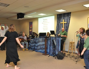 Participants dance and sing along with the worship team's music.
