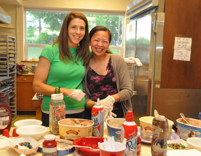 Moms Denise Hayek and Janine Cordero serve up sundaes.