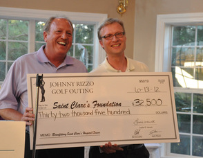 Bill Snouffer, Tournament Chair and Jeff Lamie from the Saint Clare's Foundation, hold the check raised from the golf outing.