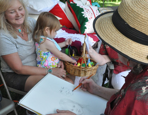 Lori Harden, portrait artist, draws Val Cerny and her granddaughter, Alaina.