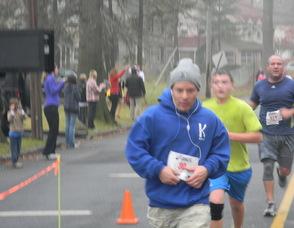 people finishing the race