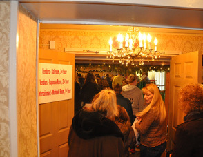 A steady stream of customers enter the Papoose Room.