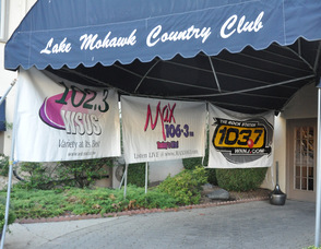 The entrance to the Lake Mohawk Country Club, with the Clear Channel station signs.