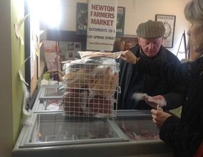 Wendy Miller purchases a pork chop, and other items, from Pat Kelly of Glenmalure Farm.