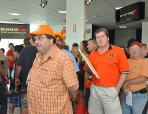 Fans dressed in orange Dukes of Hazzard wear, wait to meet the star.