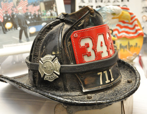 Thomas Cooney's fire helmet, which he said saved his life during his firefighting career when he was hit with debris on the head during the King riots, with a 343 placard, in memory of the New York City firefighters who died on September 11, 2001.