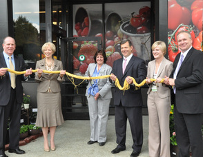 """General Store Manager Carole Bracaglia cuts the """"ribbon"""" of spaghetti, inviting shoppers to the new kings Food Market in Livingston."""