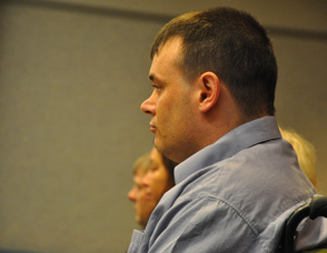 Scott Harris listens to court proceedings.