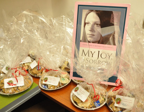 A photo of Karen Ann Quinlan is surrounded by trays of cookies in one of the offices.