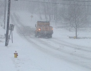 A Town of Newton DPW Truck heads up Trinity Street.