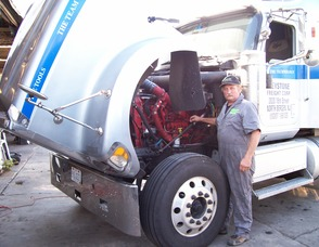 Keystone Freight, a national carrier looks for ways to become compliant.  Caption: Extreme Energy Solutions Inc. Tech Director Mark Ringen inspects arecent SMART Emissions Reducer retrofit for Keystone Freight Corp.