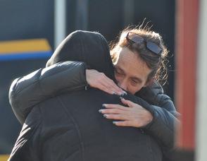 Two women embrace on the scene.
