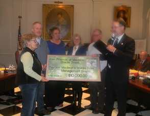 Representatives from the Madison Shade Trees Inc. doanting money to the borough