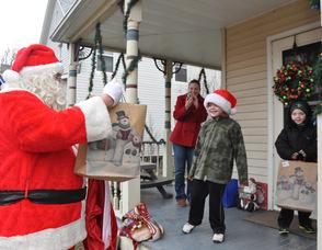Santa visits the Teets residence, to triplets Patrick, Matthew, and Jason, age 7.