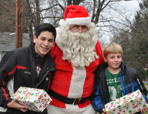Santa poses with brothers Nick and Shane Nannery, ages 13, and 10.