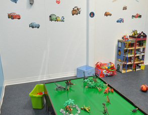 The boys' room filled with dinosaurs, blocks, trains, cars, and more, at Chuckle Time.