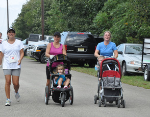 Moms and kids finish the race, including Pauline Murphy, Vicki Kowalski, and Kim Strada.