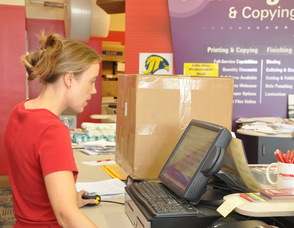 Wendy Asplund helps a customer with a shipping quote.