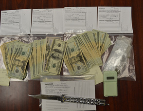 A Sparta High School senior is facing drug and weapon charges after he was caught in the school parking lot with $4,450 in cash, drugs and a knife (Photo courtesy of the Sparta Township Police Department).
