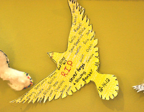 A paper dove with the names of all the victims of the Dec. 14 shooting posted on it, and hanging in the entry foyer of The Springboard Shoppes in Newton, N.J.