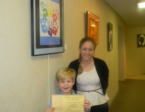 Art teacher Jaimie Bass with first grader Matthew