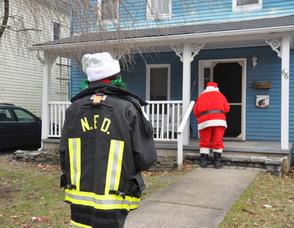 Santa and an elf make a stop.