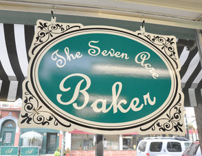 The Seven Acre Baker's sign, overlooking Spring Street.