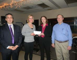Business owners donating money to the Community Service Association