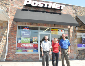 Steve Geary, Wendy Asplund, and Dan Thomas in front of PostNet Store 129.