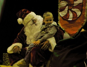 Young Kids Sit on Santa's Lap