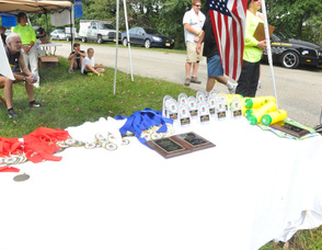 Trophies and ribbons lined up to be given out.