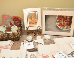 Photography by Rob Yaskovic (right) overlooks farm-inspired items, also on display.